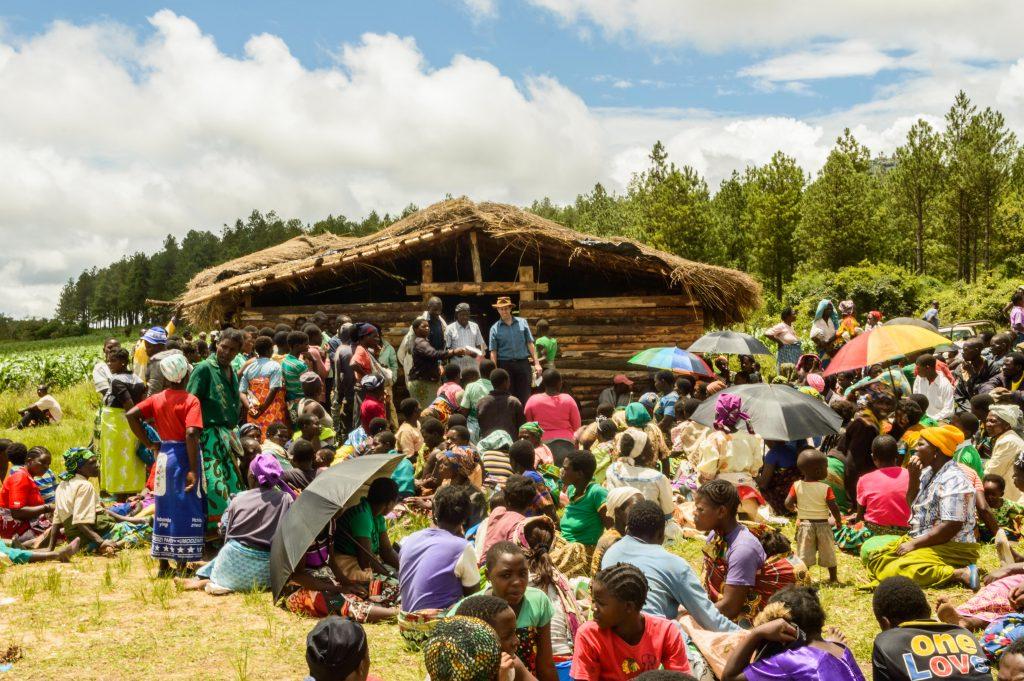 Feeding starving Malawians.